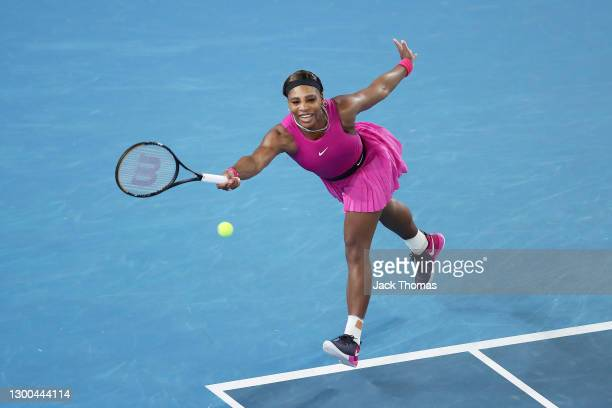 Serena Williams of The United States of America plays a forehand in her Women's Singles quarterfinals match against Danielle Collins of The United...