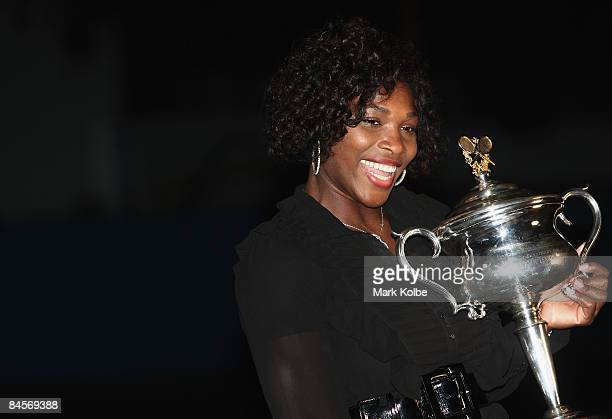 Serena Williams of the United States of America poses with the Daphne Akhurst Trophy in Garden Square during day thirteen of the 2009 Australian Open...
