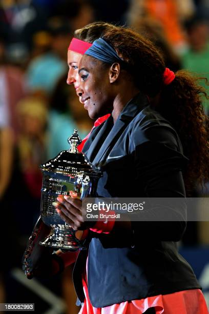 Serena Williams of the United States of America poses with the trophy after winning her women's singles final match against Victoria Azarenka of...