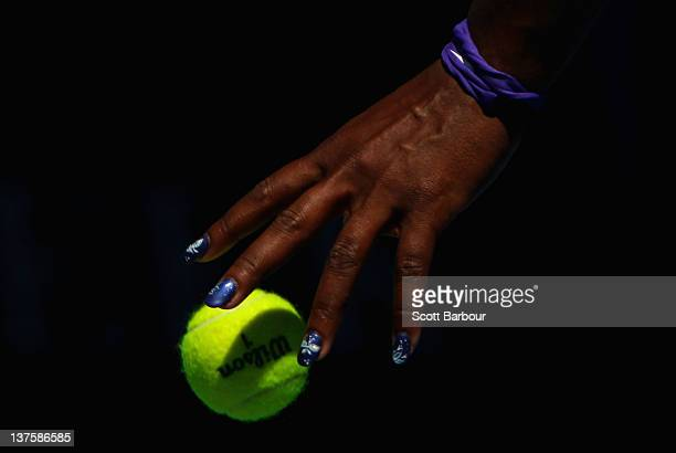 Serena Williams of the United States of America prepares to serve in her fourth round match against Ekaterina Makarova of Russia during day eight of...