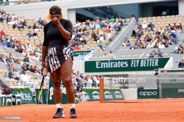 Serena Williams of The United States of America reacts during her ladies singles first round match against Kurumi Nara of Japan during Day five of...