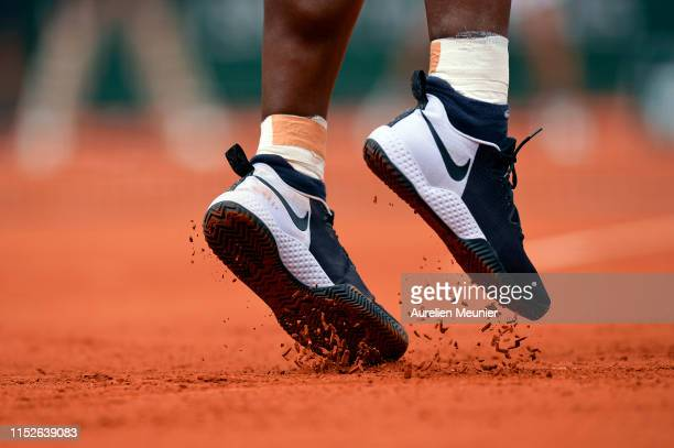 Serena Williams of The United States of America serves during her ladies singles first round match against Kurumi Nara of Japan during Day five of...