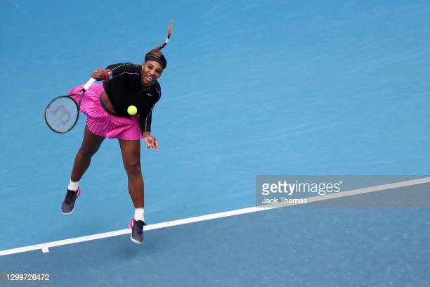Serena Williams of The United States of America serves in her Women's Singles Round of 32 match against Daria Gavrilova of Australia during day two...