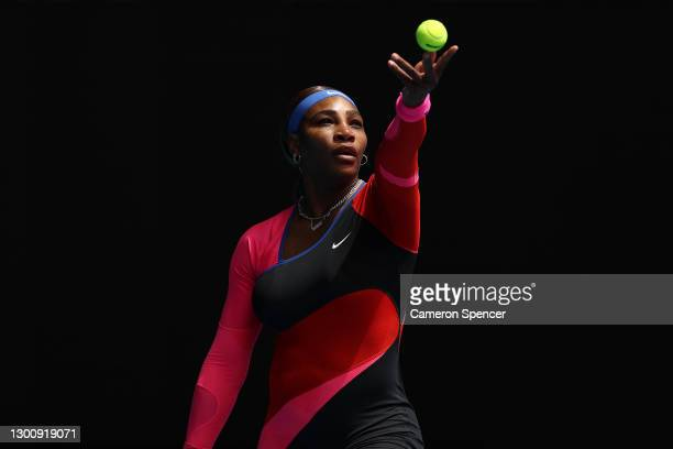 Serena Williams of The United States of America serves in her Women's Singles first round match against Laura Siegemund of Germany during day one of...