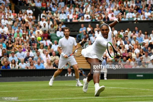 Serena Williams of the United States, playing partner of Andy Murray of Great Britain plays a backhand in their Mixed Doubles second round match...