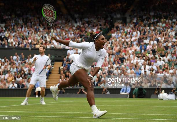 Serena Williams of the United States, playing partner of Andy Murray of Great Britain reacts in their Mixed Doubles second round match against...