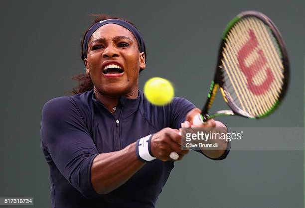 Serena Williams of the United States plays a backhand against Christina McHale of the United States in their second round match during the Miami Open...