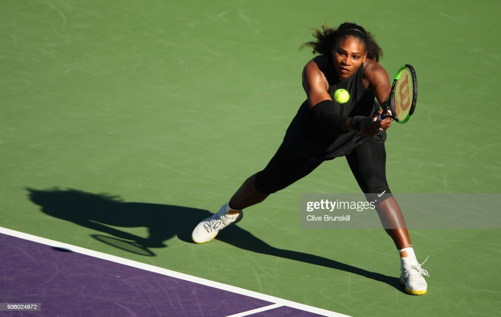 Serena Williams of the United States plays a backhand against Naomi Osaka of Japan in their first round match during the Miami Open Presented by Itau at Crandon Park Tennis Center on March 21, 2018 in Key Biscayne, Florida.