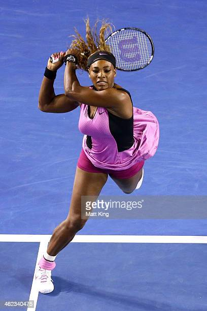 Serena Williams of the United States plays a backhand in her first round match against Ashleigh Barty of Australia during day one of the 2014...