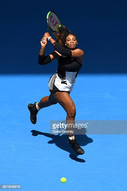 Serena Williams of the United States plays a backhand in her first round match against Belinda Bencic of Switzerland on day two of the 2017...