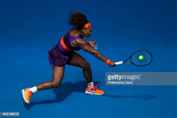 Serena Williams of the United States plays a backhand in her second round match against Garbine Muguruza of Spain during day four of the 2013...