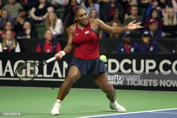 Serena Williams of the United States plays a forehand against Jelena Ostapenko of Latvia during the 2020 Fed Cup qualifier between USA and Latvia at...