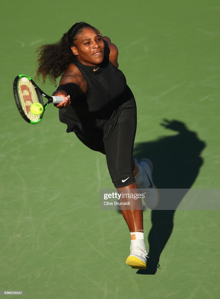 Serena Williams of the United States plays a forehand against Naomi Osaka of Japan in their first round match during the Miami Open Presented by Itau at Crandon Park Tennis Center on March 21, 2018 in Key Biscayne, Florida.