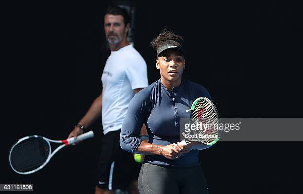 Serena Williams of the United States plays a forehand as her coach Patrick Mouratoglou looks on during a practice session ahead of the 2017...