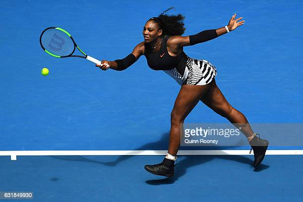 Serena Williams of the United States plays a forehand in her first round match against Belinda Bencic of Switzerland on day two of the 2017...