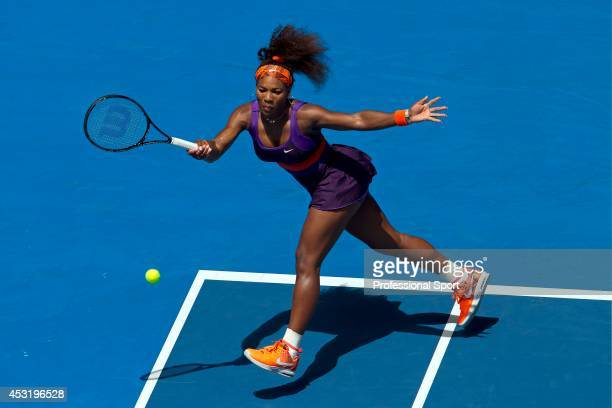 Serena Williams of the United States plays a forehand in her second round match against Garbine Muguruza of Spain during day four of the 2013...