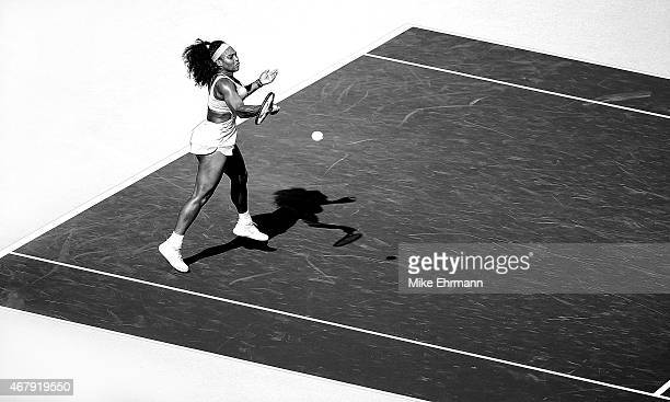 Serena Williams of the United States plays a match against Monica Niculescu of Romania during Day 6 of the Miami Open presented by Itau at Crandon...