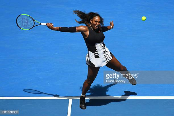 Serena Williams of the United States plays a shot in her first round match against Belinda Bencic of Switzerland on day two of the 2017 Australian...