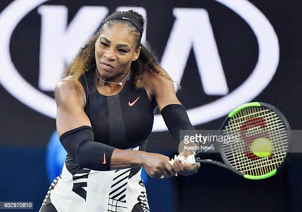 Serena Williams of the United States plays against her older sister Venus Williams in the women's singles final of the Australian Open in Melbourne...