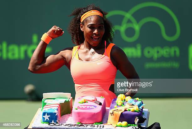 Serena Williams of the United States poses for a photograph with a cake to celebrate her 700th WTA Tour win after her three set victory against...