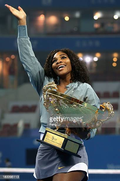 Serena Williams of the United States poses with her trophy during the medal ceremony after winning against Jelena Jankovic of Serbia on day night of...