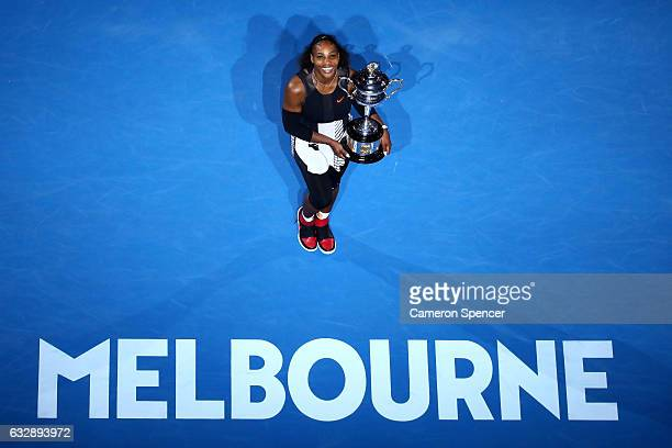 Serena Williams of the United States poses with the Daphne Akhurst Trophy after winning the Women's Singles Final against Venus Williams of the...
