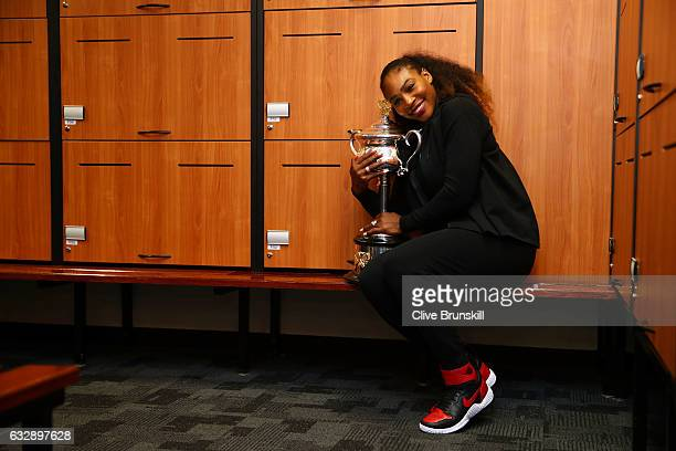 Serena Williams of the United States poses with the Daphne Akhurst Trophy in the changerooms after winning the Women's Singles Final against Venus...