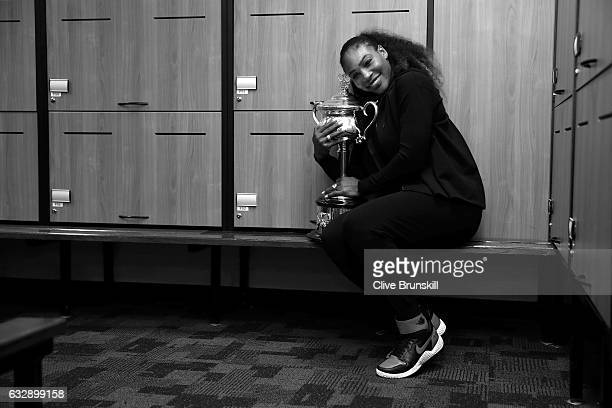 Serena Williams of the United States poses with the Daphne Akhurst Trophy in the change-rooms after winning the Women's Singles Final against Venus...
