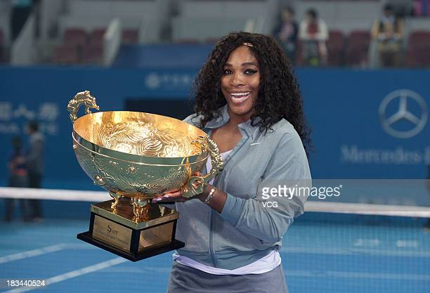 Serena Williams of the United States poses with the trophy after winning her women's final match against Jelena Jankovic of Serbia on day nine of the...