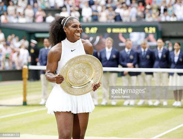 Serena Williams of the United States poses with the winner's trophy after defeating Angelique Kerber of Germany in the women's singles final at the...