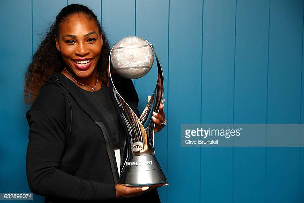 Serena Williams of the United States poses with the WTA world No1 trophy after winning the Women's Singles Final against Venus Williams of the United...
