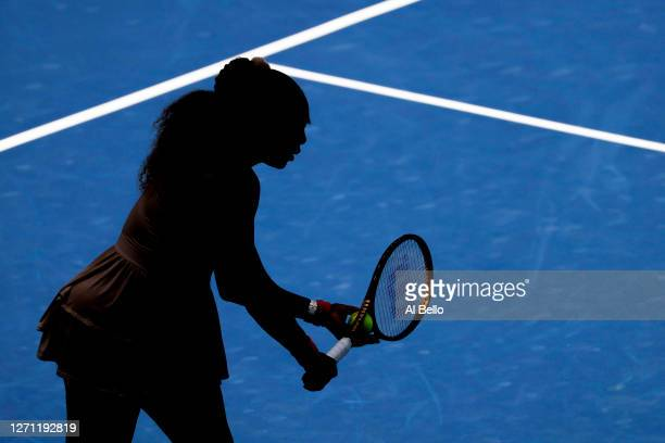 Serena Williams of the United States prepares to serve the ball during her Women's Singles fourth round match against Maria Sakkari of Greece on Day...