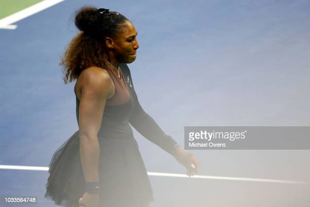 Serena Williams of the United States reacts after arguing with grand slam supervisor Donna Kelso and referee Brian Earley during her Women's Singles...