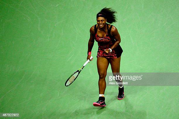 Serena Williams of the United States reacts against Venus Williams of the United States during their Women's Singles Quarterfinals match on Day Nine...