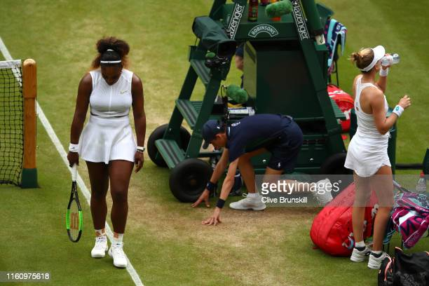 Serena Williams of the United States reacts as she walks past Alison Riske of the United States in their Ladies' Singles Quarter Final match during...