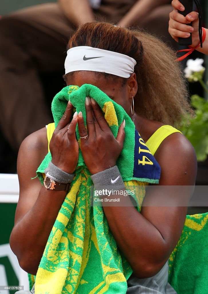 Serena Williams of the United States reacts during a break in her women's singles match against Garbine Muguruza of Spain on day four of the French Open at Roland Garros on May 28, 2014 in Paris, France.