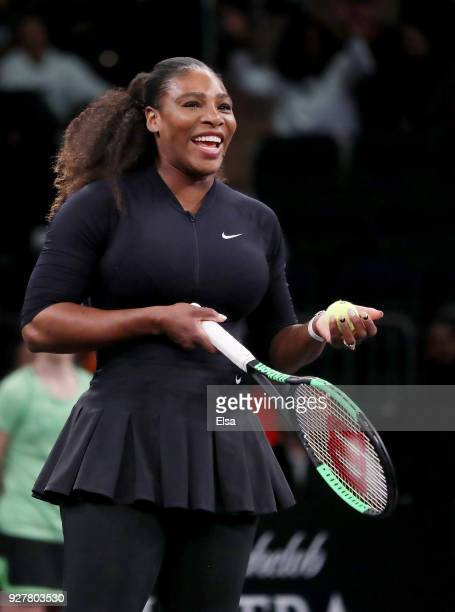 Serena Williams of the United States reacts during her match against Shuai Zhang of China during the Tie Break Tens at Madison Square Garden on March...