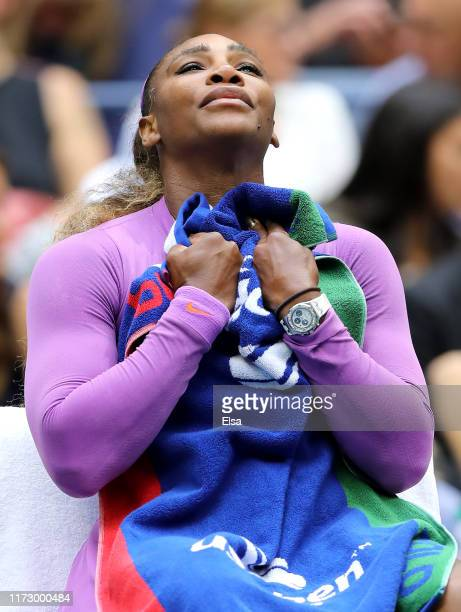 Serena Williams of the United States reacts from her chair after the first set during her Women's Singles final match against Bianca Andreescu of...