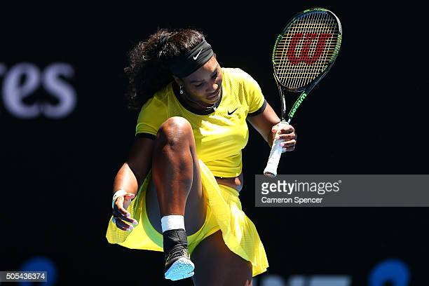 Serena Williams of the United States reacts in her first round match against Camila Giorgi of Italy during day one of the 2016 Australian Open at...