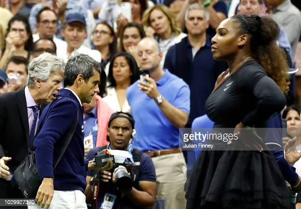 Serena Williams of the United States reacts looks on after her defeat in the Women's Singles finals match to Naomi Osaka of Japan as umpire Carlos...