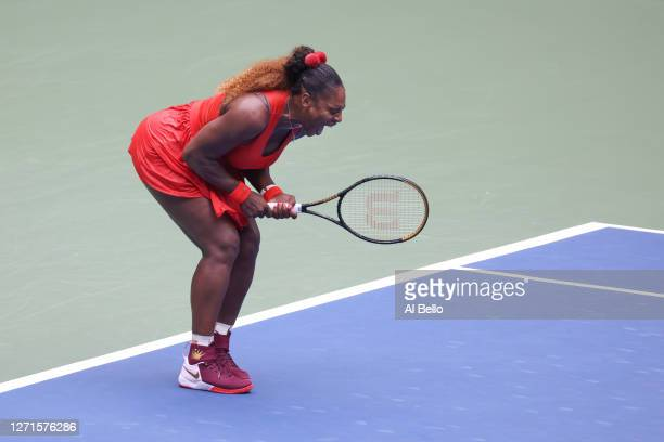 Serena Williams of the United States reacts to breaking Tsvetana Pironkova of Bulgaria in the second set during her Women's Singles quarterfinal...