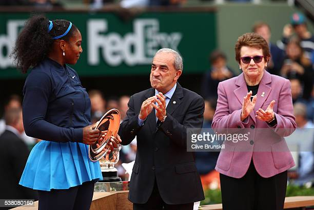 Serena Williams of the United States receives the runners up trophy from Billie Jean King and Jean Gachassin the President of the French Tennis...