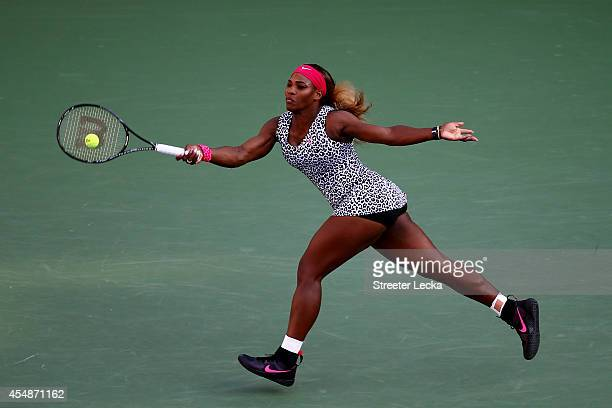 Serena Williams of the United States returns a shot against Caroline Wozniacki of Denmark during their women's singles final match on Day fourteen of...