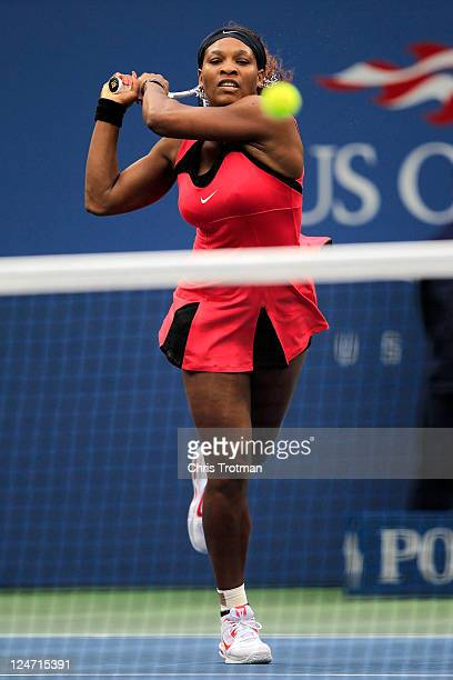 Serena Williams of the United States returns a shot against Samantha Stosur of Australia during the Women's Singles Final on Day Fourteen of the 2011...