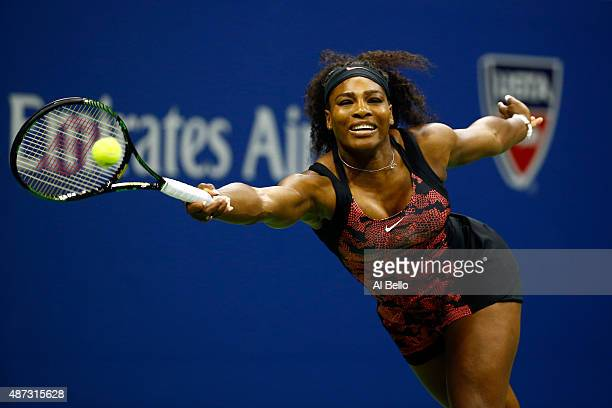 Serena Williams of the United States returns a shot against Venus Williams of the United States during their Women's Singles Quarterfinals match on...