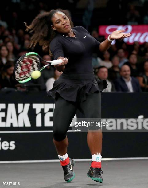 Serena Williams of the United States returns a shot to Shuai Zhang of China during the Tie Break Tens at Madison Square Garden on March 5 2018 in New...