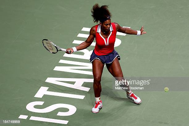 Serena Williams of the United States returns a shot to Victoria Azarenka of Belarus in round robin play during the TEB BNP Paribas WTA Championships...