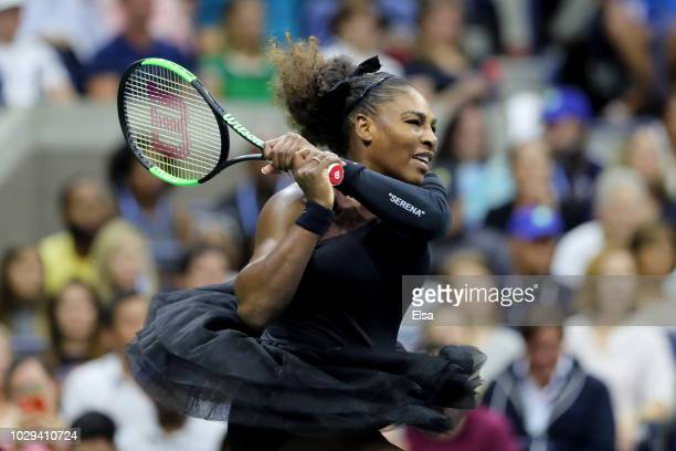Serena Williams of the United States returns the ball during her Women's Singles finals match against Naomi Osaka of Japan on Day Thirteen of the...