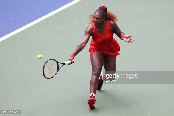 Serena Williams of the United States returns the ball during her Women's Singles quarterfinal match against Tsvetana Pironkova of Bulgaria on Day Ten...