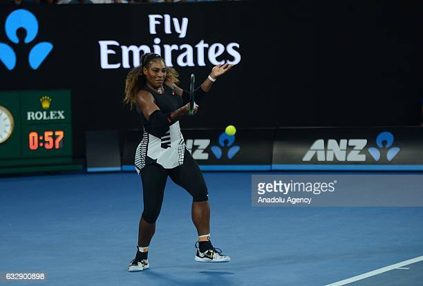 Serena Williams of the United States returns the ball during her Women's Singles Final match against Venus Williams of the United States on day 13 of...